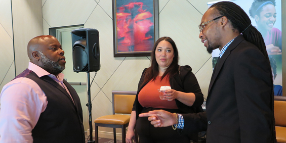Diversity, equity and inclusion attendees conversing with speaker Erik Smith